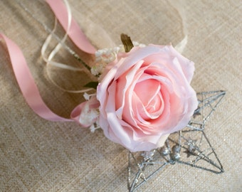Silver flower girls flower wand with blush pink rose and trailing ribbon.