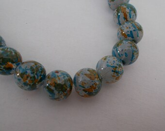 1 lot of 10 blue glass beads orange on gray background