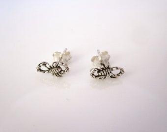 A pair of SCORPION Scorpio zodiac sterling silver stud earrings