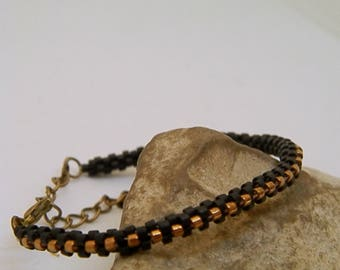 Black and bronze hand-woven bracelet
