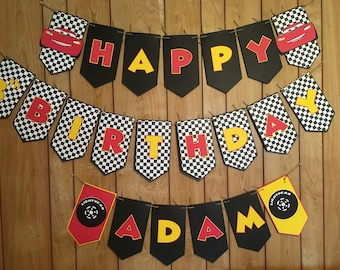 Cars themed birthday banner (comes assembled) name and number can be changed for personalization.