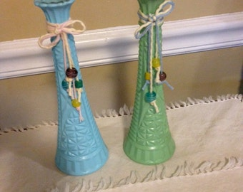 Two glass painted bud vases  green and blue
