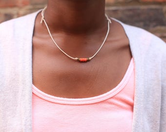 Three coral glass beads on a waxed cotton cord necklace. Wear 4 ways.