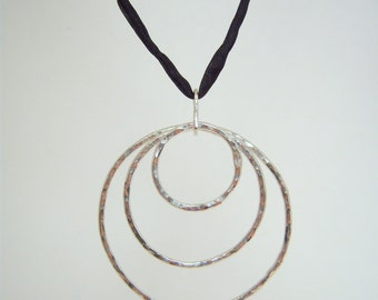 Hammered Fine Silver Triple Hoop Pendant Strung on Hand-dyed Black Silk Cord
