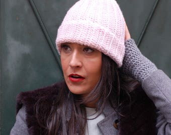 Pink baby cap with white pompom in merino wool