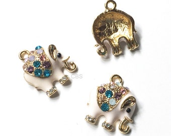 1-5 Rhinestone Pink Elephant Charms. Enameled Pink, Gold Elephant, with rhinestones.