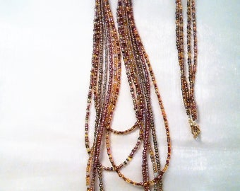 7 rows.2 artisan beads beaded NECKLACE.  . 1 set.  Shades of Brown, Brown, gold. . Unique creation. HAND made