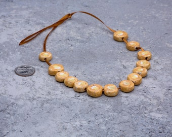 A set of 14 ceramic glazed beads Sprouting Sandscape // sand, yellow and white/ disc