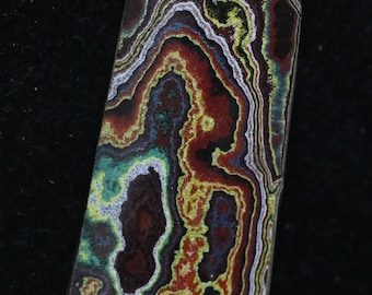 Corvettite cabochon, black brown yellow gray green blue red/maroon/carmine, 30.5ct