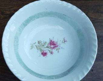 Vintage bowl. White with green trim on inside. Pink rose, floral print on inside. Made in Japan.