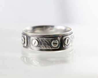 """Men no.1"" ring"