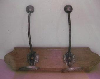 French vintage wooden coat rack with 2 big iron hooks.