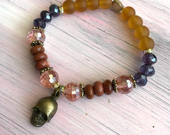 Skull bracelet with magical energy crystals