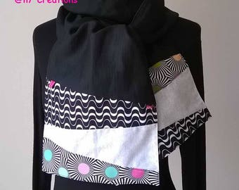 Black scarf with the ends black and white graphic.