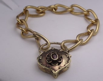 Gorgeous bracelet with substantial ornate padlock set with natural garnet