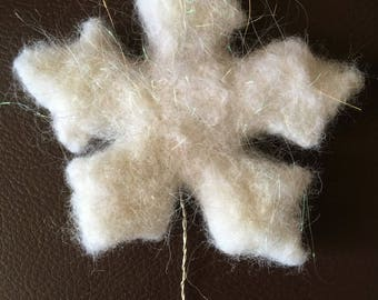 Needle felt snowflake. Wired and covered with angelina fibes to guve added sparkles