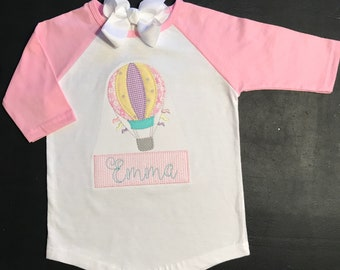 Girls pink raglan sleeve shirt with hot air balloon applique and name