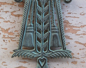 Vintage Cast Iron Wilton Brooms and Leaves Footed Trivet