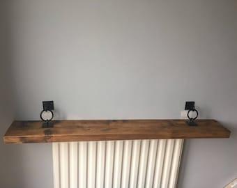 Rustic hanging/floating shelf with black metal brackets
