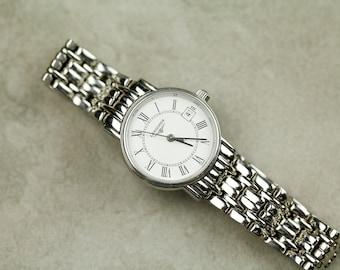 Vintage Longines Ladies quartz watch with original steel bracelet white dial