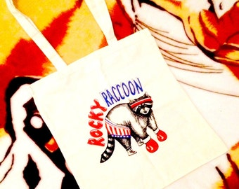 ROCKY RACCOON // Blue Red Black on Cream Cotton Tote Bag
