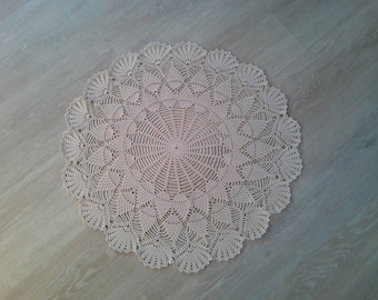Crocheted ecru cotton doily