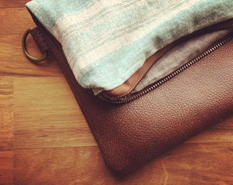 Small leather fold over clutch