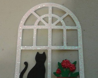 Windowsill with cat and flowers