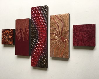 Abstract Acrylic wall art in reds and oranges. Contemporary collage on wood. Feature wall