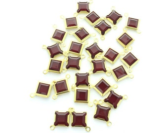Swarovski 8mm square channels set into brass settings with 2 loops.  Price is for 30 pieces
