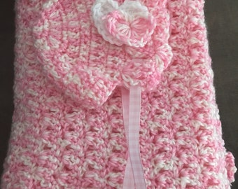 Hand crocheted baby blankets and or infant's hats..