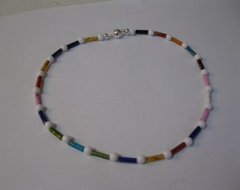Necklace different color tube spacer beads and white round acrylic beads