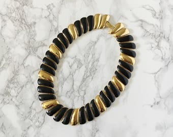 black and gold swirl necklace