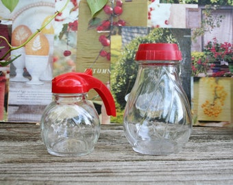 Vintage 1950's Small Syrup Pitcher and Shaker With Red Tops