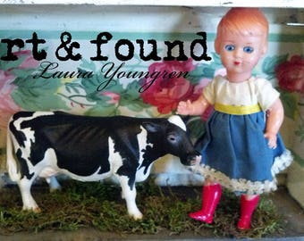 cowgirl, art assemblage, vintage floral wallpaper, vintage doll, toy cow, one of a kind, unique shadowbox by Laura Youngren
