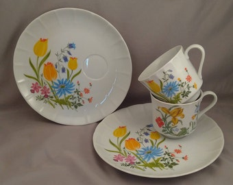 Two Bright Floral Porcelain Breakfast/Snack Sets, Cups and Plates