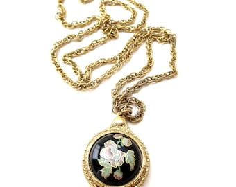 Vintage 1928 Company Circular Shaped Gold Tone Metal Painted Green & Pink Floral / Flower Cabochon Hidden Sliding Mirror Pendant Necklace