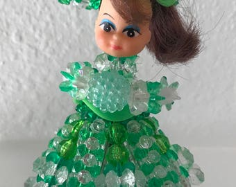 Vintage hand crafted bead and safety pin  doll