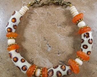 Cheetah African bracelet of Krobo beads from Ghana, bone beads and recycled orange glass - AB11
