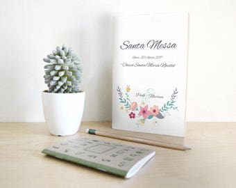 Matching wedding booklet with invitations. Floral style with mint green details.
