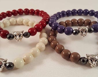 Enchanting filigree beaded bracelets made of acrylic beads, hematite and a tiger köpfle