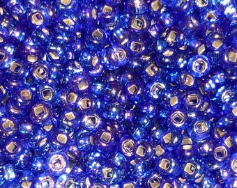 25 Grams Blue AB Silver Lined Size 6 Seed Beads - with flashes of purple