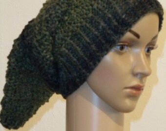 Knitted stocking cap of green color gradient yarn