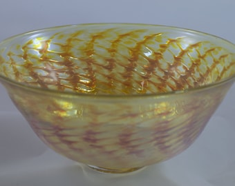 Handblown iridescent yellow glass bowl with stunning pattern and red highlights