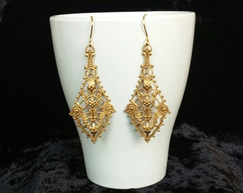 Silver earrings with golden bath and brass filigree