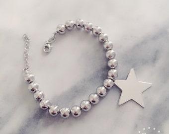 Ball bracelet with big star