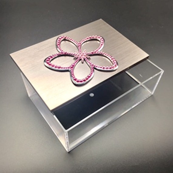 Swarovski studded pink flower on clear lucite jewelry box with