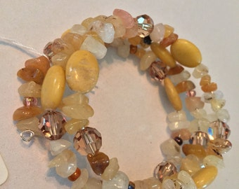 Memory wire beaded three ring bracelet in tans and cream