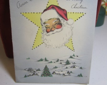 1940 Norcross christmas card Santa claus inside a star looking down over snow covered village glitter accents
