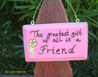The greatest gift is a friend sign